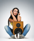 Young beautiful girl in headphones with speaker Royalty Free Stock Image