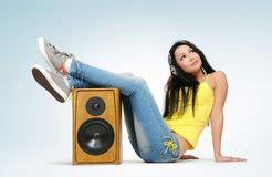 Young beautiful girl in headphones with speaker Stock Images
