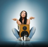 Young beautiful girl in headphones with speaker Stock Photo