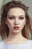 Young beautiful girl headshot portrait. Young beautiful model, portrait.  Outdoor shoot Royalty Free Stock Photo