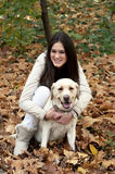 Young beautiful girl and her dog Royalty Free Stock Photos
