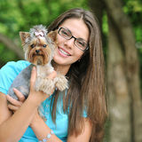 Young beautiful girl with her puppy outdoor Stock Photos