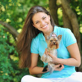 Young beautiful girl with her puppy outdoor Stock Photo