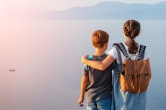 Young beautiful girl with her younger brother traveling along the coast of the Mediterranean Sea royalty free stock photography