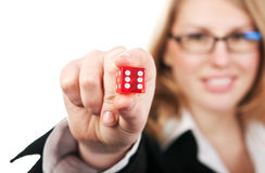 Young beautiful girl holding dice Stock Images
