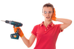 Young beautiful girl holding a drill and closed her eyes Royalty Free Stock Photo