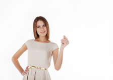 Young beautiful girl holding an imaginary credit card Royalty Free Stock Images