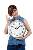 Young beautiful girl holding a large wall clock. Stock Image