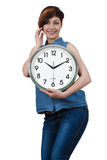 Young beautiful girl holding a large wall clock Royalty Free Stock Image