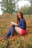 Young, beautiful girl holding an open book, read Royalty Free Stock Photography