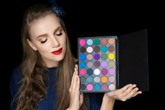 Young beautiful girl holding palette stock photography