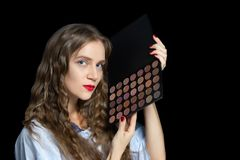 Young beautiful girl holding palette with shadows stock photography