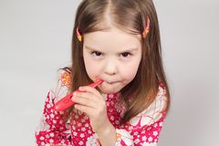 Young beautiful girl holding a red thermometer Royalty Free Stock Photo