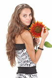 Young beautiful girl holding sunflower Stock Images