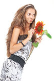 Young beautiful girl holding sunflower Stock Photo