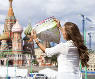 Young beautiful girl holding a tourist map of Moscow Royalty Free Stock Image