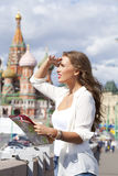 Young beautiful girl holding a tourist map of Moscow Stock Photos