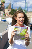 Young beautiful girl holding a tourist map of Moscow Royalty Free Stock Photography
