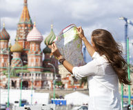 Young beautiful girl holding a tourist map of Moscow Stock Photo