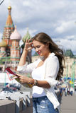 Young beautiful girl holding a tourist map of Moscow Stock Photography