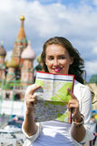 Young beautiful girl holding a tourist map of Moscow Royalty Free Stock Images