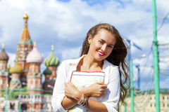 Young beautiful girl holding a tourist map of Moscow Royalty Free Stock Photos