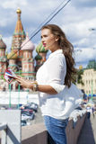 Young beautiful girl holding a tourist map of Moscow, Russia Stock Image