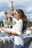 Young beautiful girl holding a tourist map of Moscow, Russia Royalty Free Stock Image