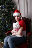 Young beautiful girl holding a white cat Stock Photography