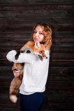 A young beautiful girl holding a wild fox animal that was traumatized by a man and rescued by her and now lives as before Stock Image