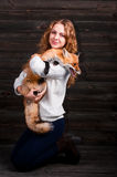 A young beautiful girl holding a wild fox animal that was traumatized by a man and rescued by her and now lives as before Royalty Free Stock Photography