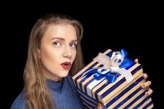 Young beautiful girl holds big gift box royalty free stock photo