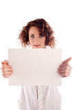 Young beautiful girl holds a empty white sign for you to fill in Royalty Free Stock Images
