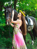 Young beautiful girl with a horse in forest Stock Image