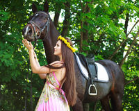 Young beautiful girl with a horse Royalty Free Stock Image