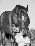 Young beautiful girl  with horse in W&B Royalty Free Stock Image