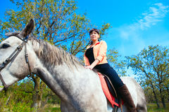 Young beautiful girl on horse walk Royalty Free Stock Image