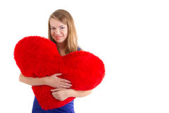 Young beautiful girl hugs a big soft heart Stock Photography