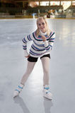 Young beautiful girl ice skating Royalty Free Stock Photos