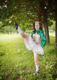 Young beautiful girl in irish dance dress dancing outdoor Stock Photos