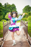 Young beautiful girl in irish dance dress having fun outdoor Royalty Free Stock Image