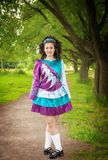 Young beautiful girl in irish dance dress posing outdoor Royalty Free Stock Photography