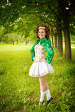 Young beautiful girl in irish dance dress posing outdoor Royalty Free Stock Image