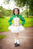 Young beautiful girl in irish dance dress posing outdoor. Young beautiful girl in irish dance dress and wig posing outdoor Royalty Free Stock Photo