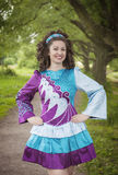 Young beautiful girl in irish dance dress posing outdoor Stock Image