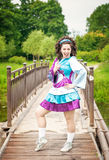 Young beautiful girl in irish dance dress and wig having fun Stock Image