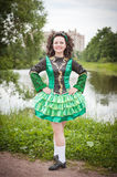 Young beautiful girl in irish dance dress and wig posing Stock Photo