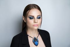 Woman bright blue make up royalty free stock photography