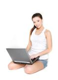 Young beautiful girl with laptop Royalty Free Stock Photography