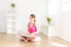 Young beautiful girl with a laptop at home Stock Photography